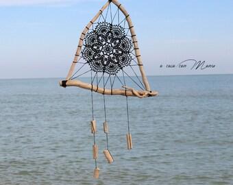 Black dream catcher in natural sea wood