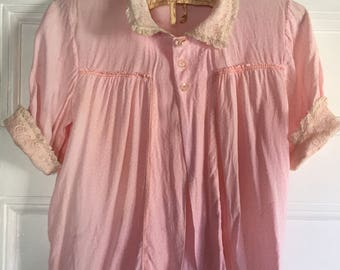 1930s 40s bed jacket with lace collar and cuffs. Embroidered mended patches