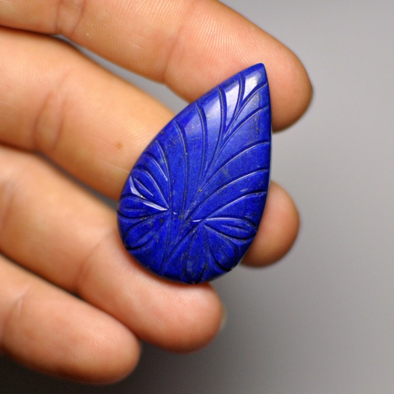Natural Carved Blue Lais Lazuli Adornment Pear Cabochon Glorious Gemstone Pendant size 40x24x5 mm 47.45 Cts.