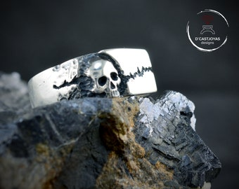 Silver signet skull ring with rock texture