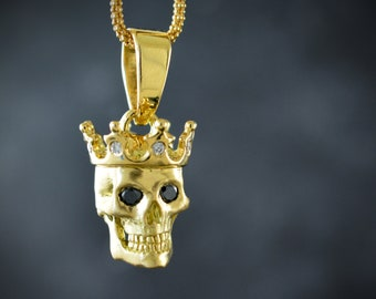 Solid gold Skull king pendant  with black diamonds and natural rubies
