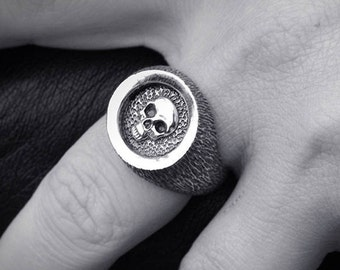 Silver signet ring with hammered textures and relief skull sealf
