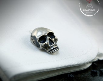 Silver skull cufflinks with oxidised textures