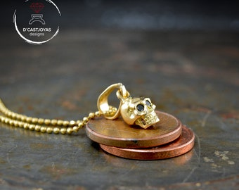 Solid 18K Gold skull pendant with natural stones