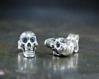 Skull earrings handmade in Sterling silver, Smeil skull stud