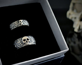 Set of handmade skull alliances in sterling silver and hammered textures