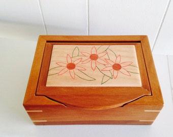Handmade keepsake or jewelry box with flower design in lid.