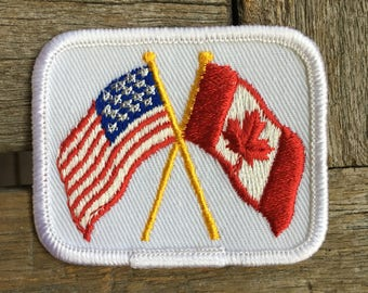 US and Canadian Flags Vintage Travel Souvenir Patch by Voyager - New in Original Package