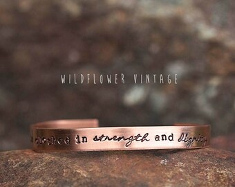 She is clothed in strength and dignity Copper Cuff Bracelet | Hand Stamped Christian Bible verse Proverbs 31:25 Religious Gifts for Her