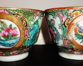 Pair of late Qing dynasty or earlier Republic Chinese porcelain tea cups detail painted Canton enamel medallion court figurines