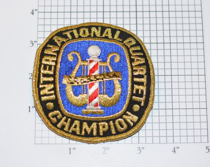 International Quartet Champion SPEBSQSA Embroidered Pin (Society for Preservation & Encouragement of Barber Shop Quartet Singing in America)