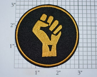Raised Clenched Fist (Gold on Black) Iron-On Embroidered Patch Symbol of Solidarity Unity Strength Defiance Resistance for Jacket Vest Shirt