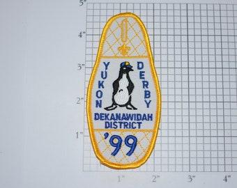Yukon Derby Dekanawidah District 1999 Embroidered MINT Sew-On Vintage Patch Boy Cub Scout BSA Collectible Penguin Emblem Keepsake Memento