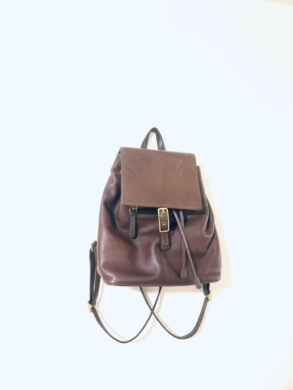 Minimalist backpack. Brown leather backpack. Coach