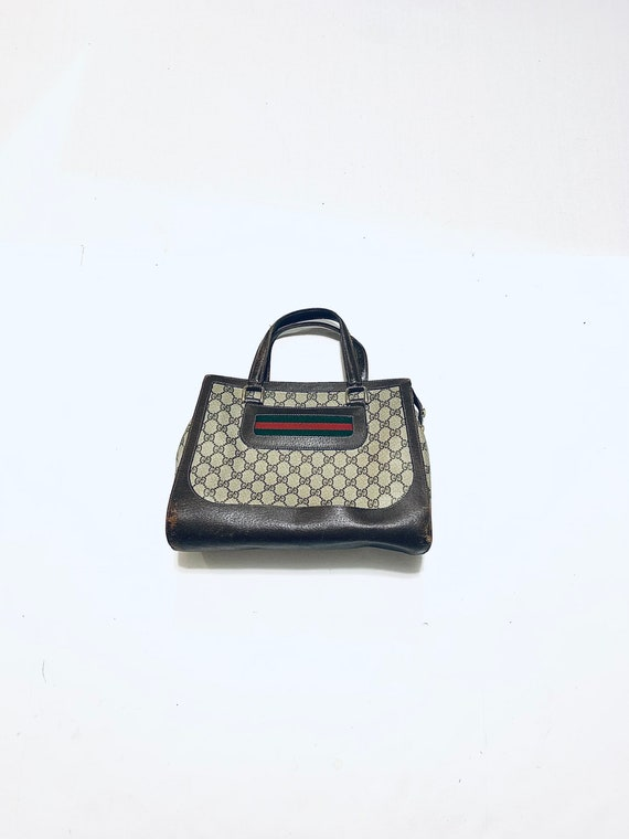 1970's GUCCI handbag. Brown vinyl, leather trimmed