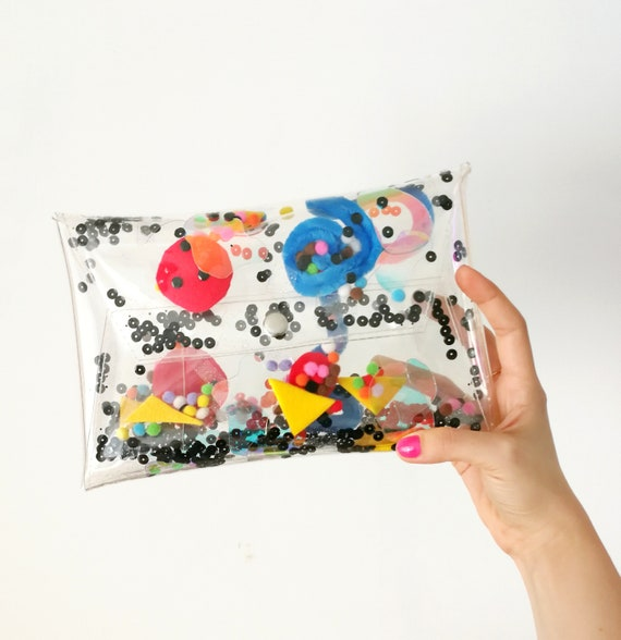80s style bag, for art girl, abstract art fashion, random unique shape bag, kandinsky inspired, sequins glitter handbag with moving interior