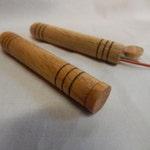 wooden toothpick holder or needle case, pocket sized, handturned from oak wood, light brown in color