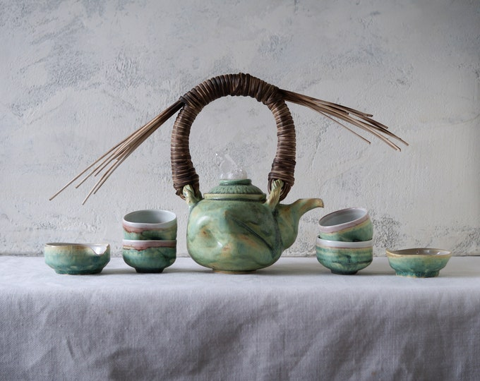 Featured listing image: Handmade Ceramic Tea Ceremony Set, Seven Pieces, Exclusive Patina Green Glaze, Cups, Woven Reed Teapot, Nature Inspired Pottery, 20 oz