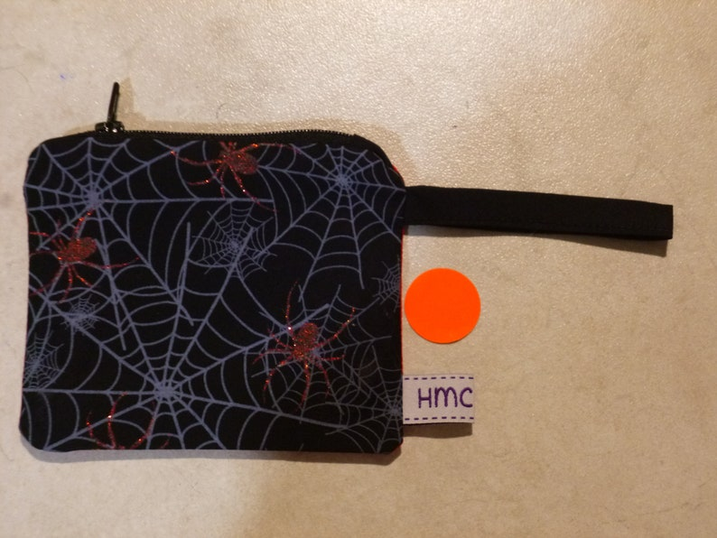 Mini zippered bag Fully lined Ideal for coins lipstick,etc. 11cm  x 9cm approx Washable Checkered lining Sparkle Spiders print