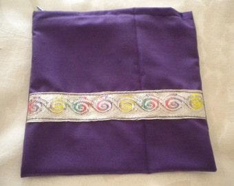 Small zippered bag.  Purple with lurex trim. 15cm x 15cm. Washable.