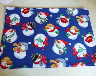 Placemat and Drink Coaster set. Snowman. Royal blue Backing. washable. Great gift