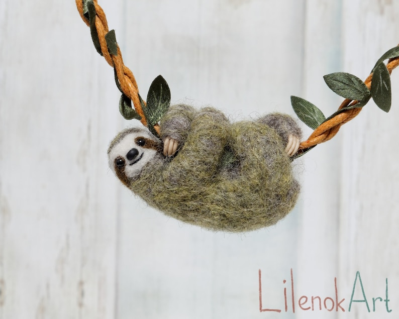 Needle Felted Sloth necklace in olive green color the cord with leaves