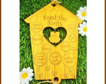 A Wooden 'Feed The Birds' Garden Sign and Bird Feeder