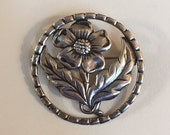 Vintage Sterling Silver Stamped Single Flower with Leaves in Round Decorative Frame Brooch