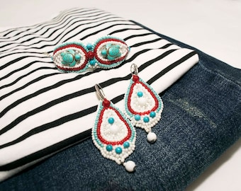 Jewelry set handmade beadwork . Earrings and a bracelet . White , Turquoise , red
