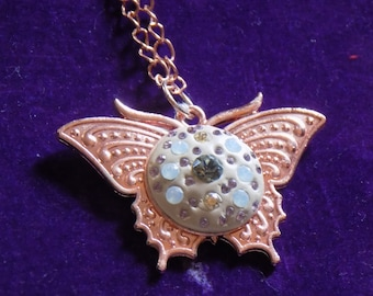 Rose gold plated butterfly pendant set with Swarovski Ceralun and Swarovski crystals on a rose gold plated chain.
