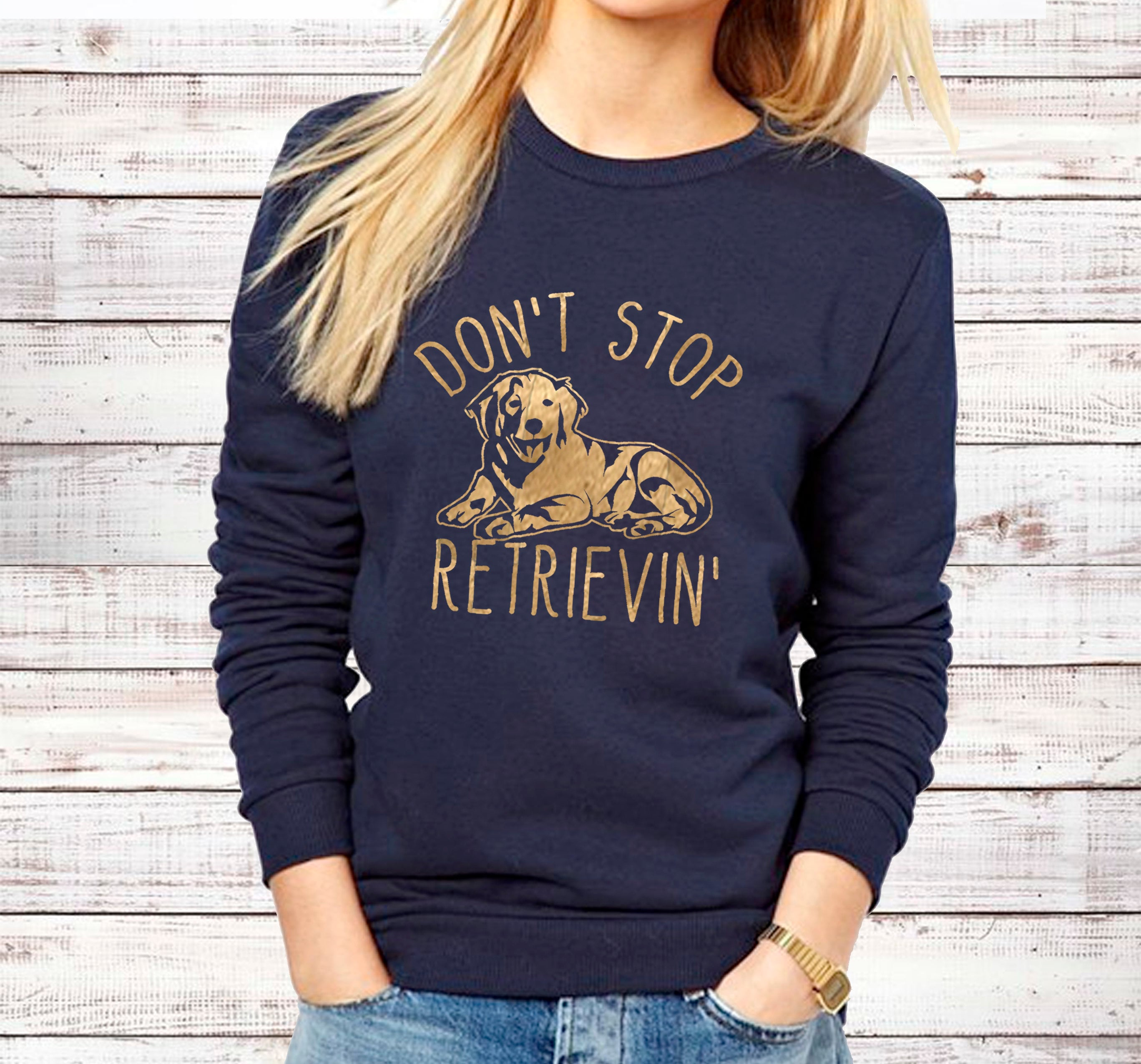 "Navy blue sweatshirt with golden retriever graphic and the words ""Don't Stop Retrievin' ""."