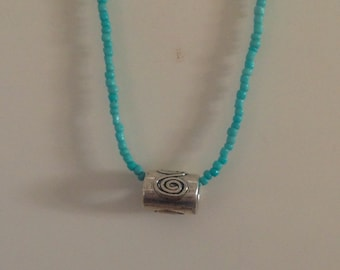 Turquoise and silver-tone charm necklace