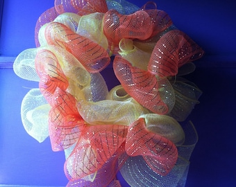 This is a little fall wreath with orange and yellow deco mesh