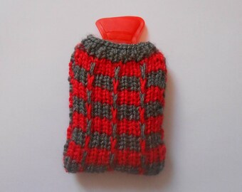 Water bottle pocket heater covered with handmade knitted cover