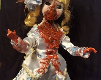 Scary, creepy, bloody porcelain doll
