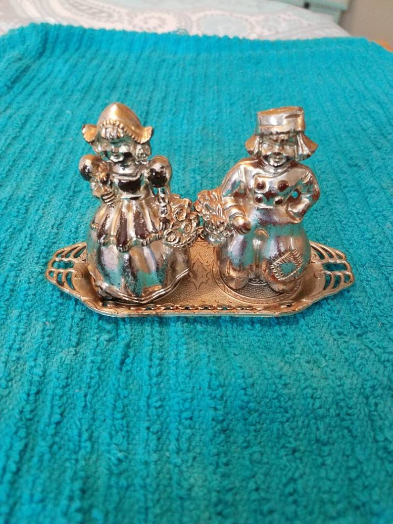 Man and woman Couple  with Baskets  on Tray Salt and Pepper Shakers set