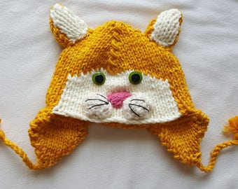 e4064fcbe68 Kids Hand Knit Orange Kitty Cat Hat with Ear Flaps and Tassels