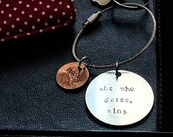 She who dares, wins key chain: feminist words of widsom to inspire courage. Makes a great birthday gift or best friends BFF present.