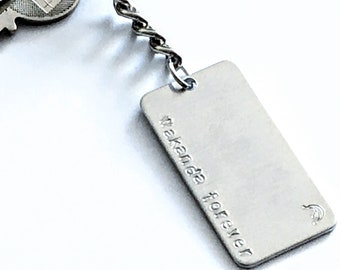 Black Panther key chain: Wakanda Forever. Quote and battle cry from movie. Great gift for a Wakandan!