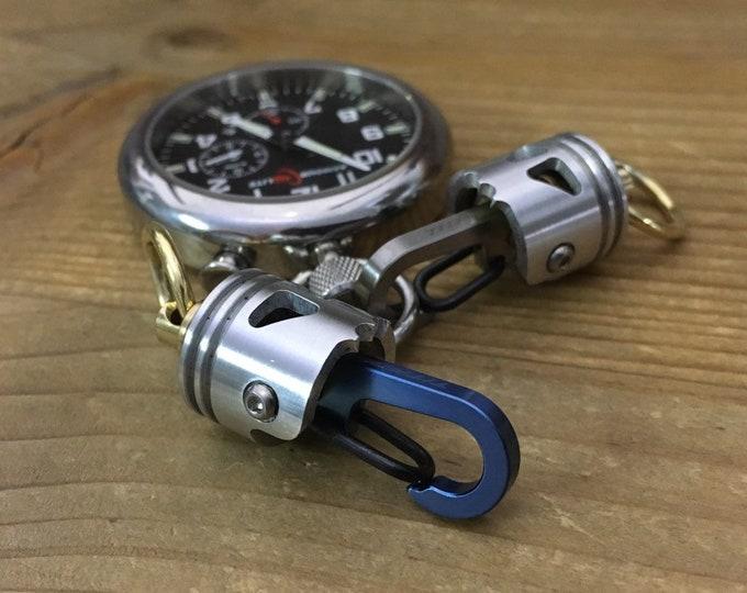 Swivel Skull Piston Bob Keychain with Titanium Clip