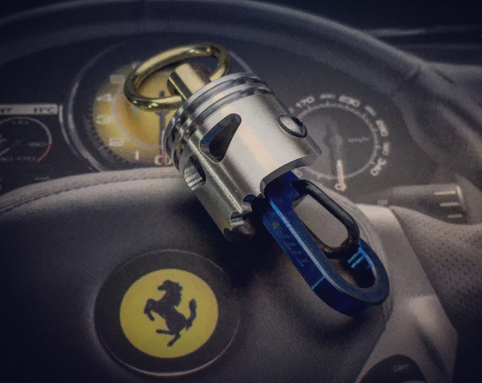 Rotating Skull Piston Bob Keychain. with titanium clip and closed brass ring