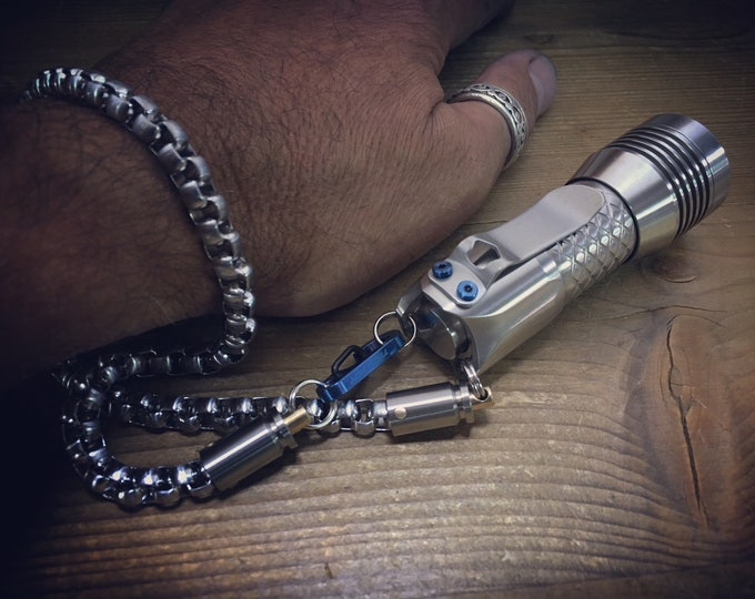 Lanyard hand or safety, for flashlight. Extra strong and rotating. Titanium and Stainless Steel