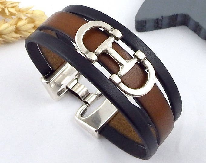 black and Brown bit leather bracelet and silver plated clasp
