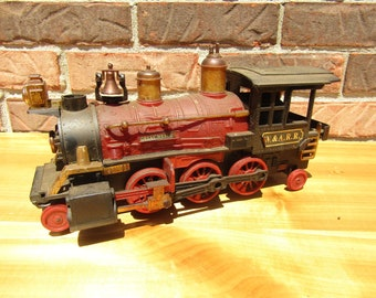 Vintage toy train engine made by New Bright Company red train care engine Christmas train car vintage industrial