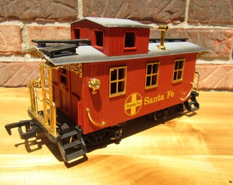 Vintage New Bright Company train car Santa Fe with decorative gold trimming red train set pull behind