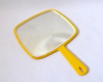 Vintage retro yellow plastic hand mirror. Retro 1970s hand-held. Mid century dressing table/make-up/vanity. Hanging hole. Made in Japan, 70s