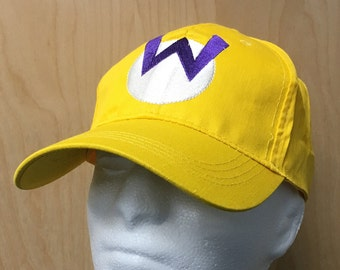 1b615046efa Wario Hat Baseball Cap Halloween Costume W Logo Cosplay Video Game Kart Cart  Yellow 80s 90s Mario Evil Villain Gamer Embroidery Gift Idea