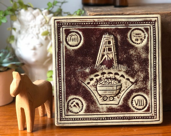 """Hemming Nilsson ceramic wall tile wall plaque signed entitled """"kol och lera"""" meaning Coal and clay in Swedish stamped 1977 Lions Club"""