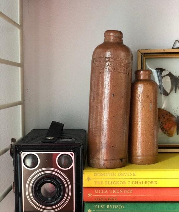 Small Antique Dutch stoneware liquor bottles from Amsterdam / ERVEN LUCAS Bols  Het LOOTSJE  / sold as pair
