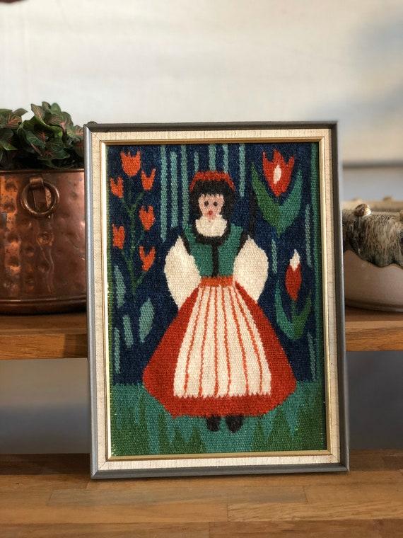 Handwoven kilim wallhanging scandinavian girl Flemish slow art flamsk green blue red white scandi boho traditional dress